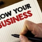 Conceptual hand writing showing Grow Your Business. Business photo showcasing improve your work enlarge company overcome competitors written by Man Notebook Book Wooden background Marker.